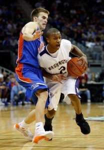 Little Isaiah Thomas leads a quick Huskie backcourt. (Getty Images)