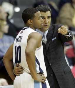 Jay Wright, seen here giving Corey Fisher some fashion tips, has done a great job at 'Nova this season. (AP Photo)